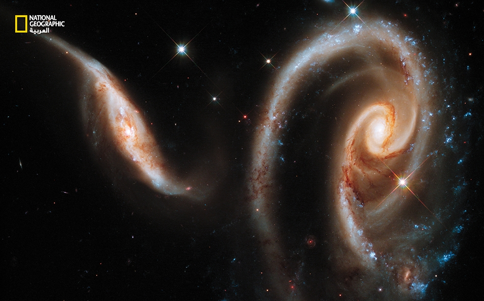 تدعى مجموعة المجرّات البعيدة هذه باسم (Arp 273).